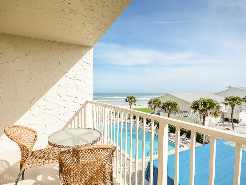 Enjoy ocean views and relax by the oceanside on the private balcony.