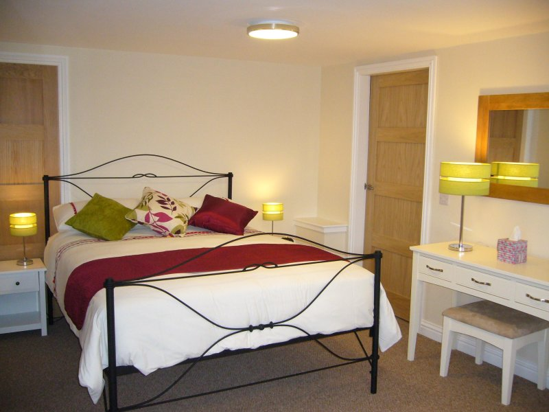 Large spacious bedroom with kingsize bed