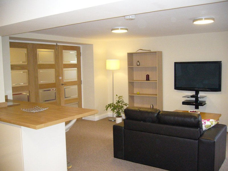 Living room space with wall mounted TV.