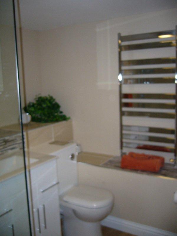 Plenty of space for toiletries, heated towel rail.