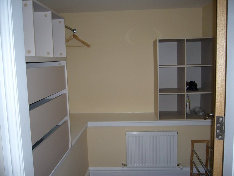 Walk in dressing room, with ample storage space.