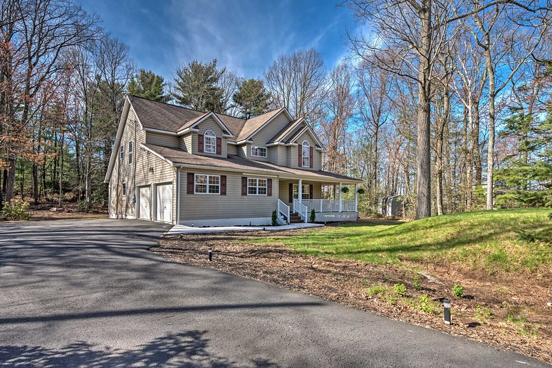 Leave your worries behind and escape to this lavish 4-bedroom, 3.5-bathroom Tannersville vacation rental house that comfortably sleeps 16!