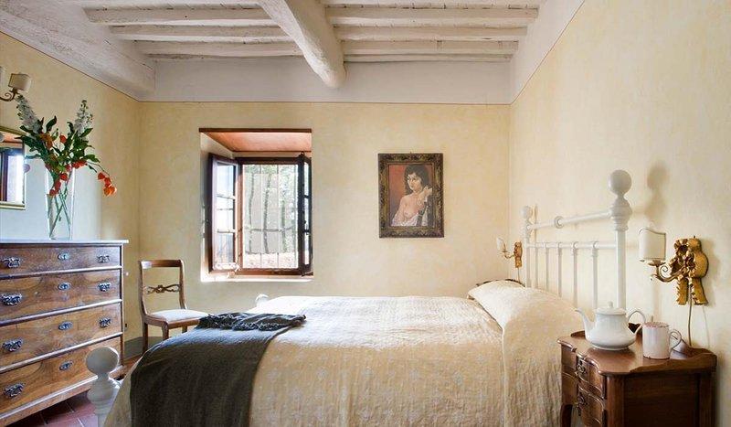 begane grond slaapkamer met tweepersoonsbed