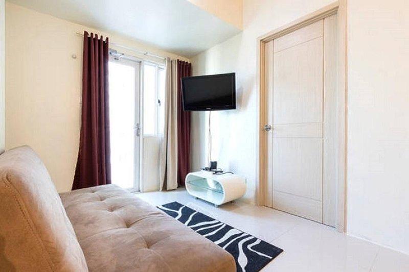 Sala de estar cuarto conduce a la terraza