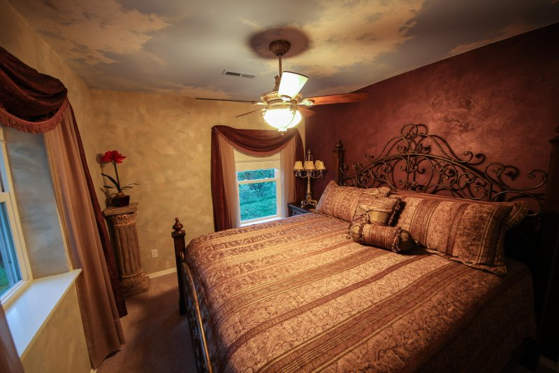 Beautifully decorated bedroom with King sized bed and upgraded bedding.