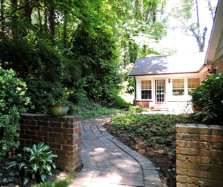 A winding brick path leads you to the Hidden Cottage