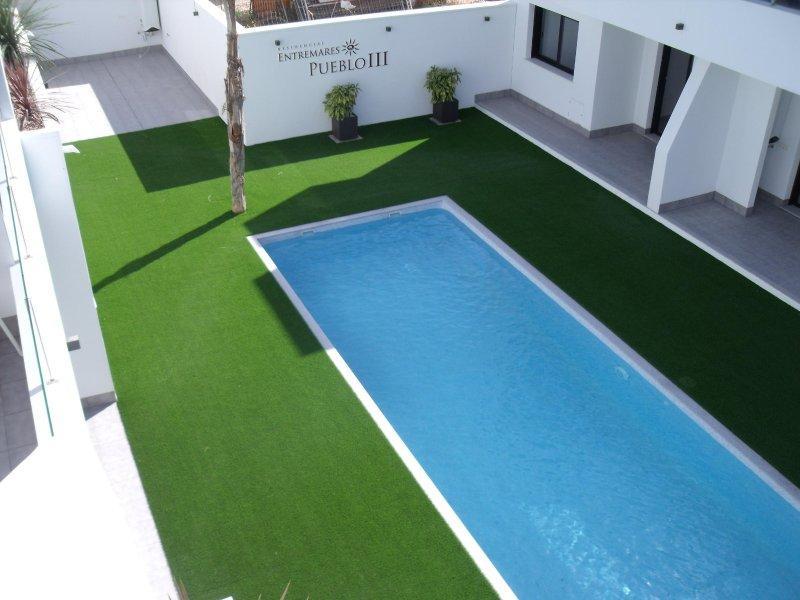 Vista a la piscina desde el solarium