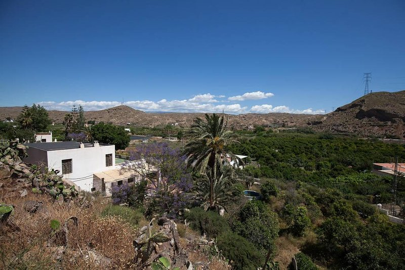 Overview of the house, among orange trees and overlooking the desert of Tabernas