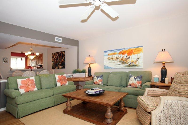 Living Room one step down from Dining Room and Kitchen offers comfortable sofas by Thomasville