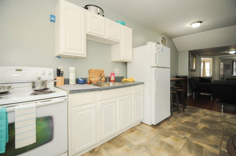 Fully stocked kitchen with all amenities, pots, pans, dishes, utensils, oven, stove etc.