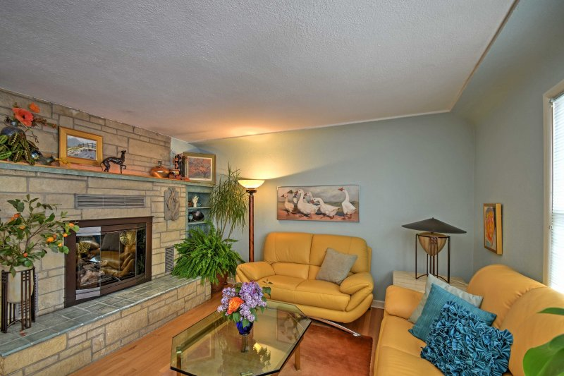 Relax on the leather furniture in the living room after an outdoor adventure.