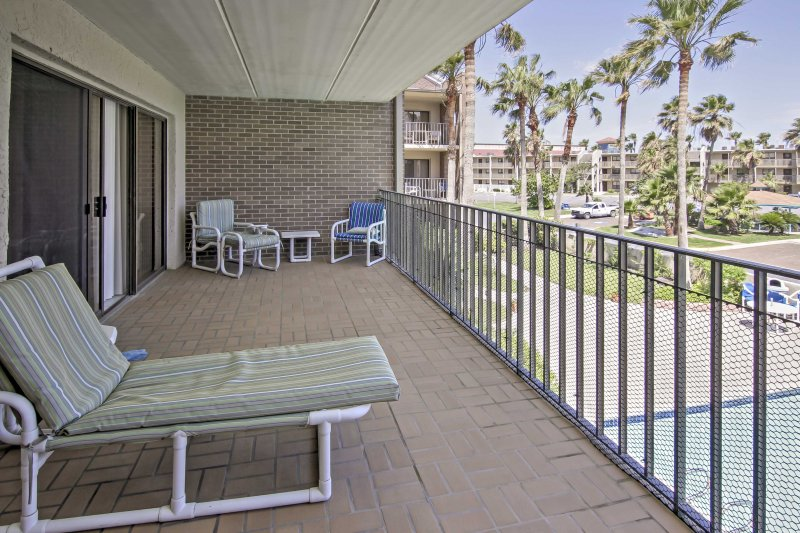 The second-floor unit features a deck which overlooks the community pool.