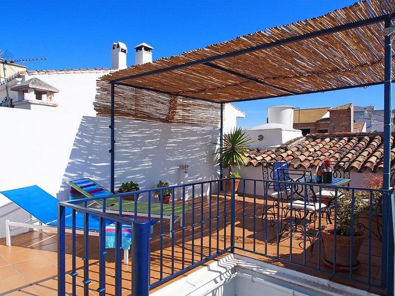 Terrasse sur le toit, le soleil et l'ombre