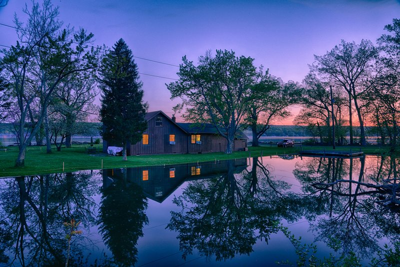 Surrounded by water! Back of house across private cove; Cayuga Lake surrounds on other side. ©2016