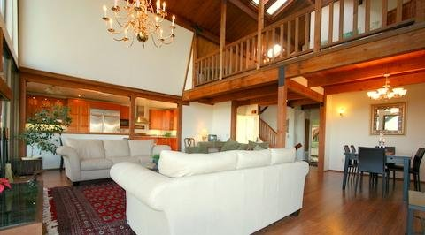 Large Great Room with open American style kitchen - opens to large decks and views