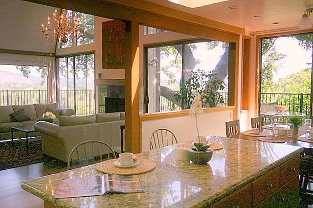 Open American Style Kitchen seats 2 at counters, 8 at table - adjoining open dining area for 10