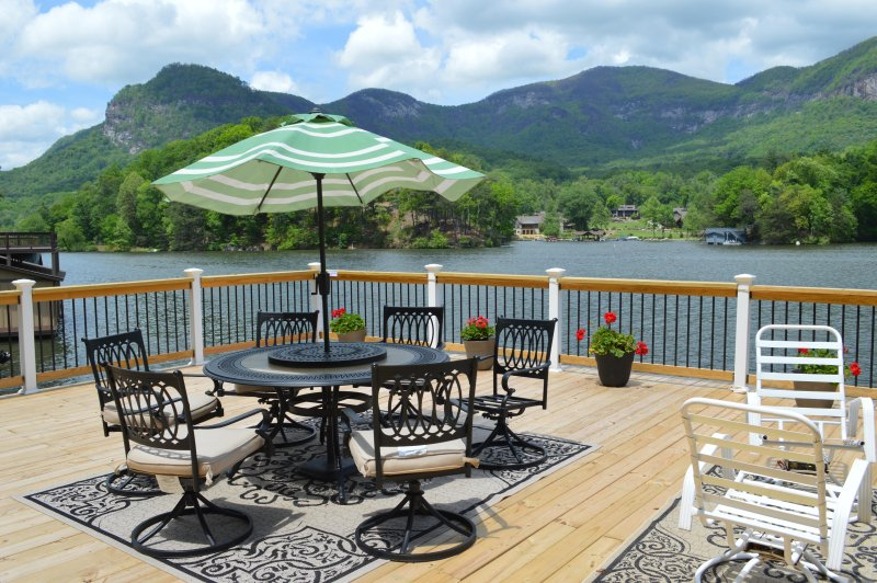 Most spectacular and the best views of the lake and Mountains from the deck and the Den.