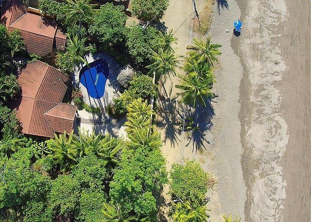 Aerial view of Casa Milagro on the beach
