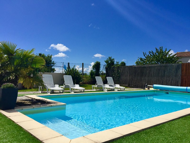 Heated/fenced private swimming pool just minutes from sandy beaches
