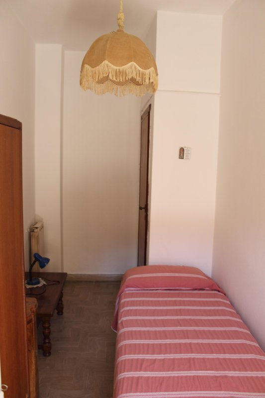 Bedroom with balcony. Single room.