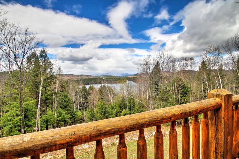 Enjoy breathtaking views while you lounge on the expansive back porch at this Greenwood vacation rental home!