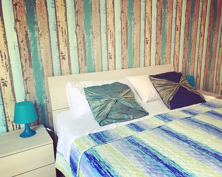 Bedroom with double bed, sofa bed, TV, air conditioning