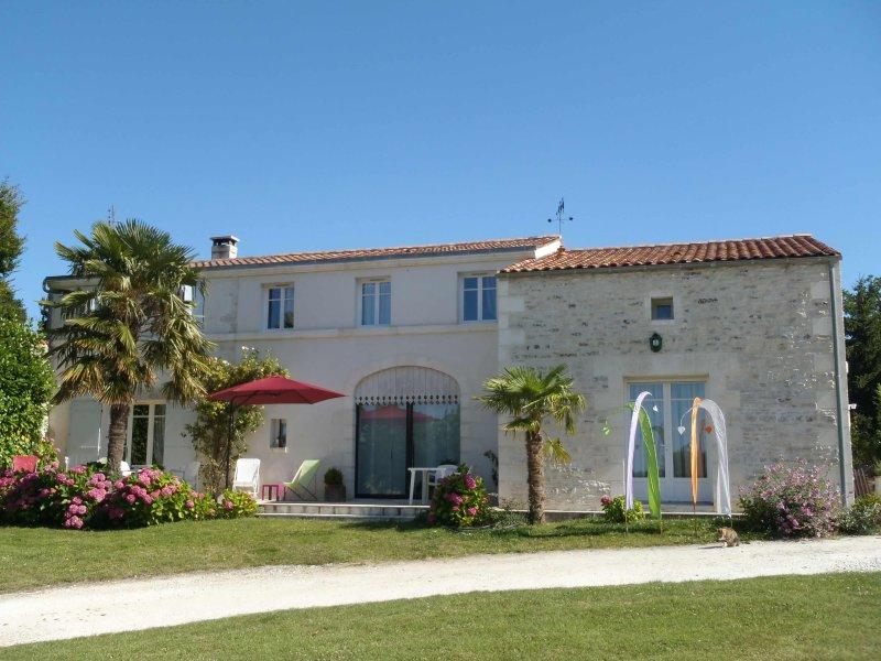 The Logis de la Brumanderie facing the golf cottage and guest house