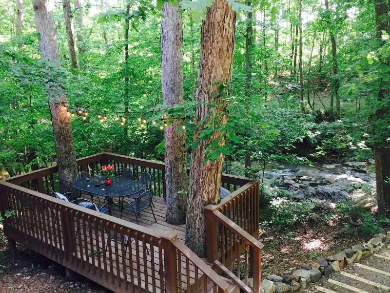 The lower deck at the back of the house overlooks the creek running through the property.