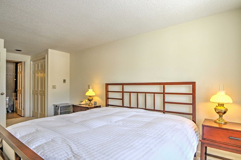 This master bedroom features a comfortable top-quality king-sized mattress.
