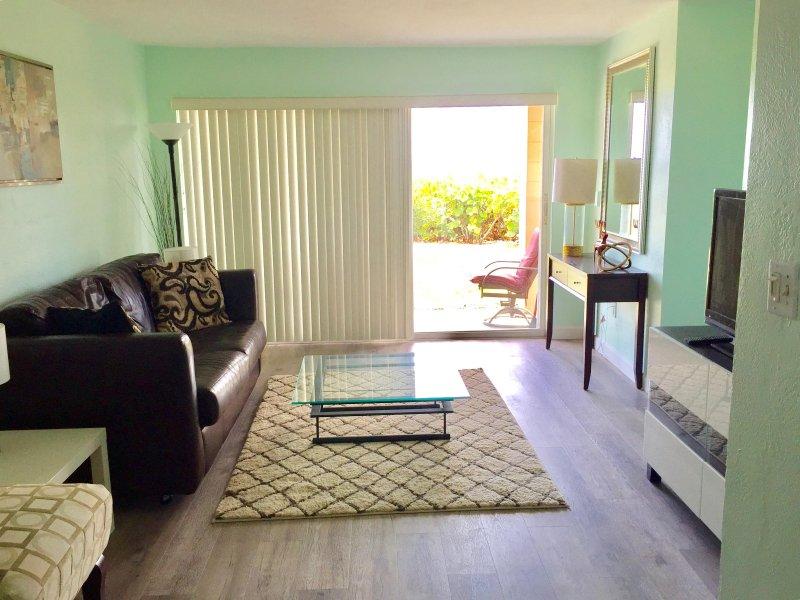 Sala de estar abre para a praia
