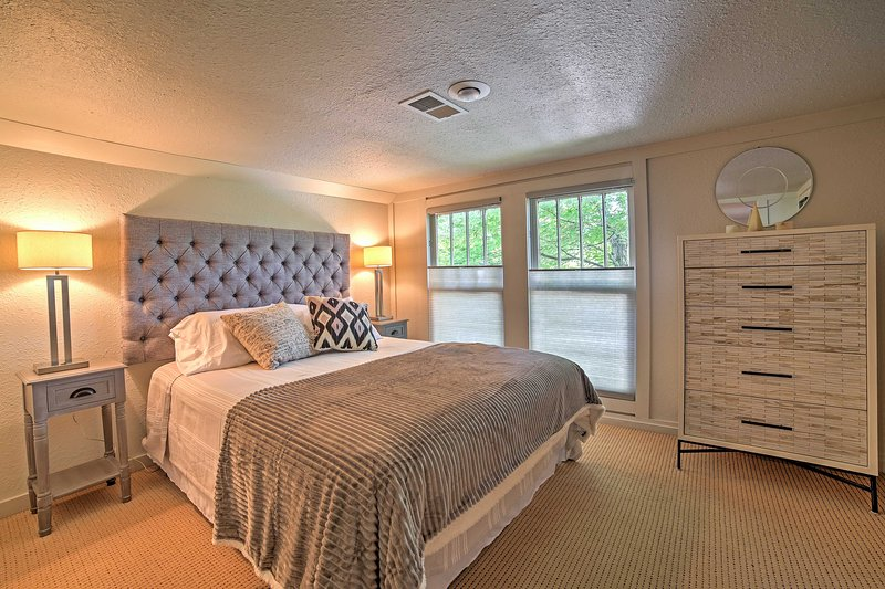 Enjoy gorgeous nature views from this inviting bedroom.