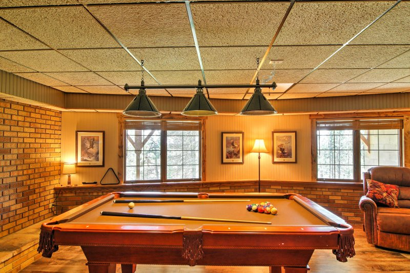 Boasting 2,400 square feet of comfortable living space, a hot tub, pool table, foosball table and dartboard, this home ensures endless entertainment.