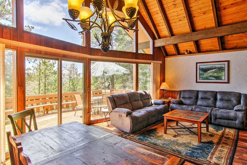 Upon entering this cabin style home, you'll instantly be charmed by the beautiful hardwood floors and rustic decor seen throughout the entire house.
