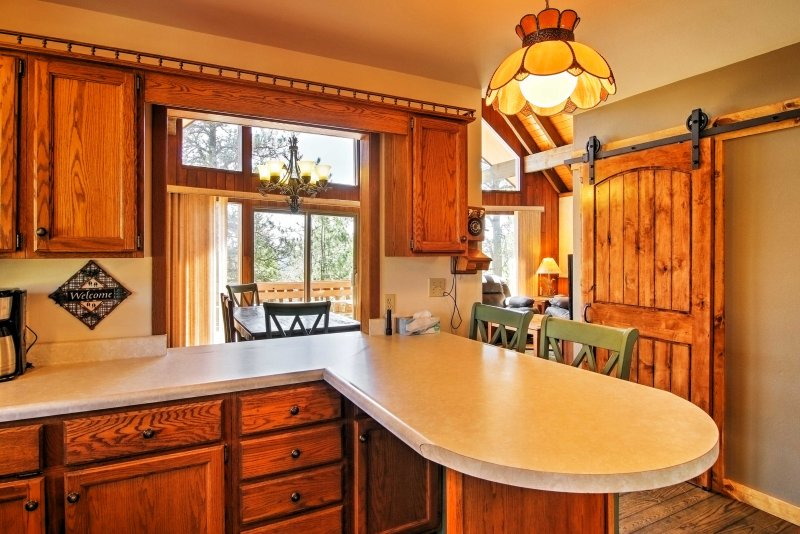 A breakfast bar offers seating and extra counter space.