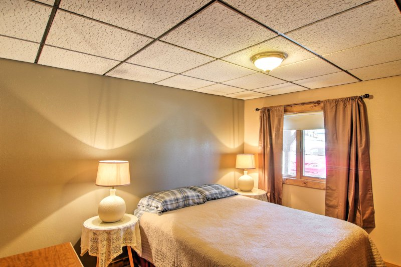 A queen-sized bed is located in the 4th bedroom.
