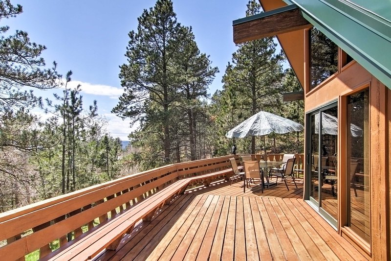 Step outside to the large wrap-around deck that offers splendid views and outdoor furniture.