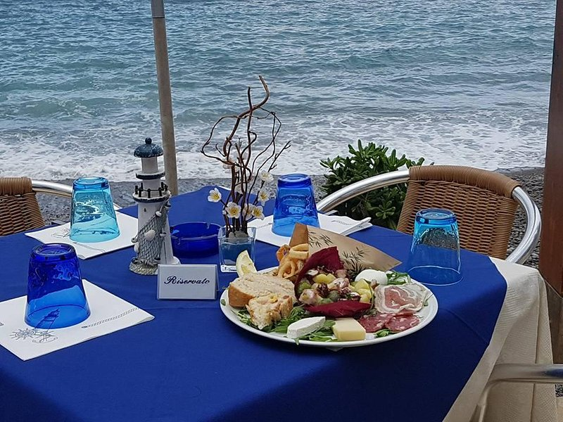 Table on the beach for breakfast, lunch and dinner.