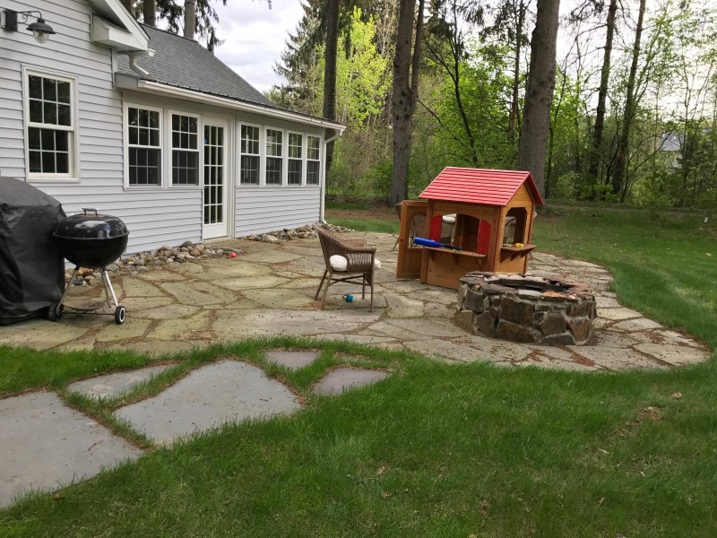 Main  Spacious flagstone patio for grilling entertaining and late evening fire