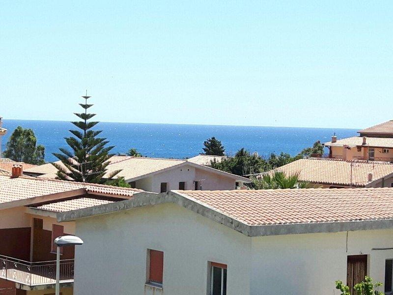 mansarda vista mare, alquiler de vacaciones en Cala Gonone