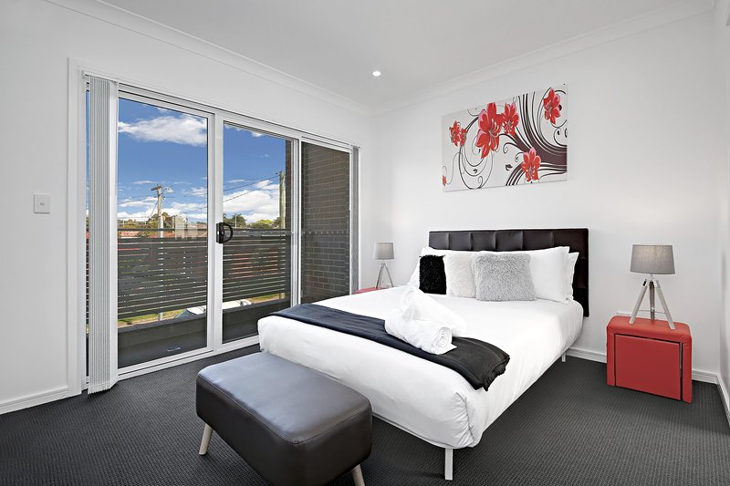 Master Bedroom with Queen Bed, an Ensuite and a private balcony