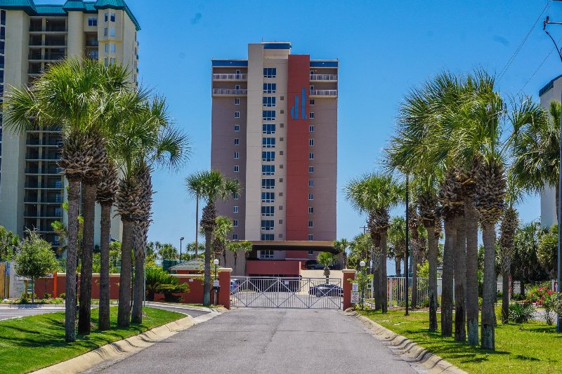 View of Destin Towers from Street.  Security Gate on Driveway Entrance