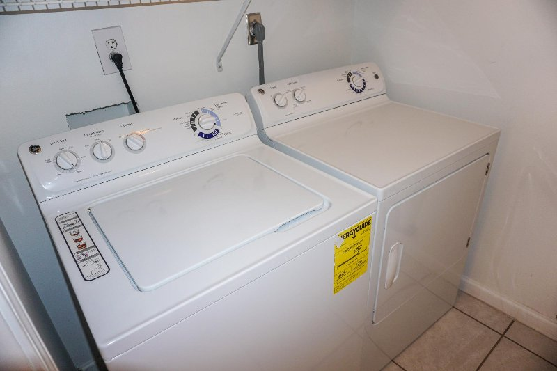 Utility Room with Washer & Dryer off of Kitchen
