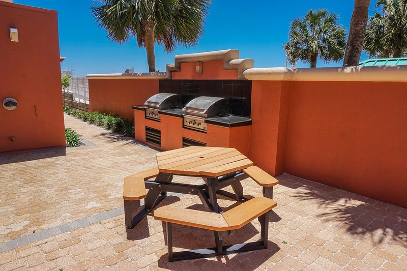 Bar-B-Que Area:  (2) Gas Grills & (2) Charcoal Grills
