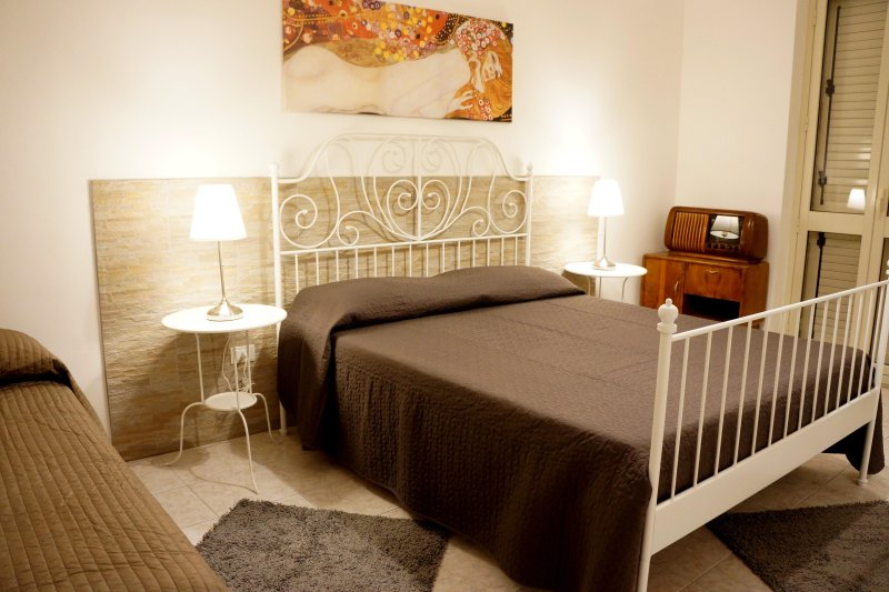 Bedroom with double bed and single bed. fairly large room with window.