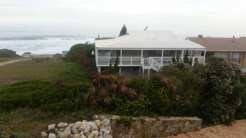 House and beach, showing deck around the house and distance to the beach