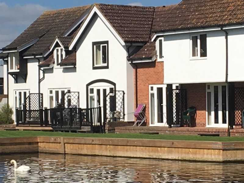 Rear of Holkham Cottage, right on the River Bure with private mooring.