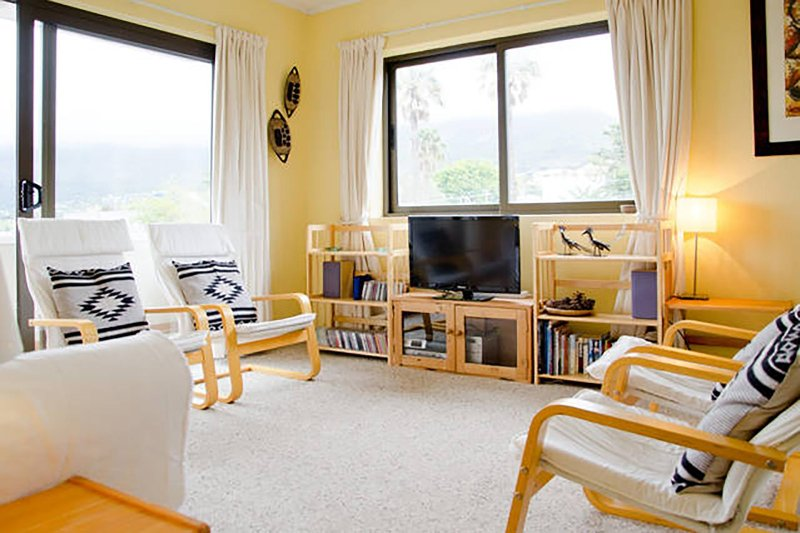 Our warm and welcoming living room with views of Table Mountain to die for.