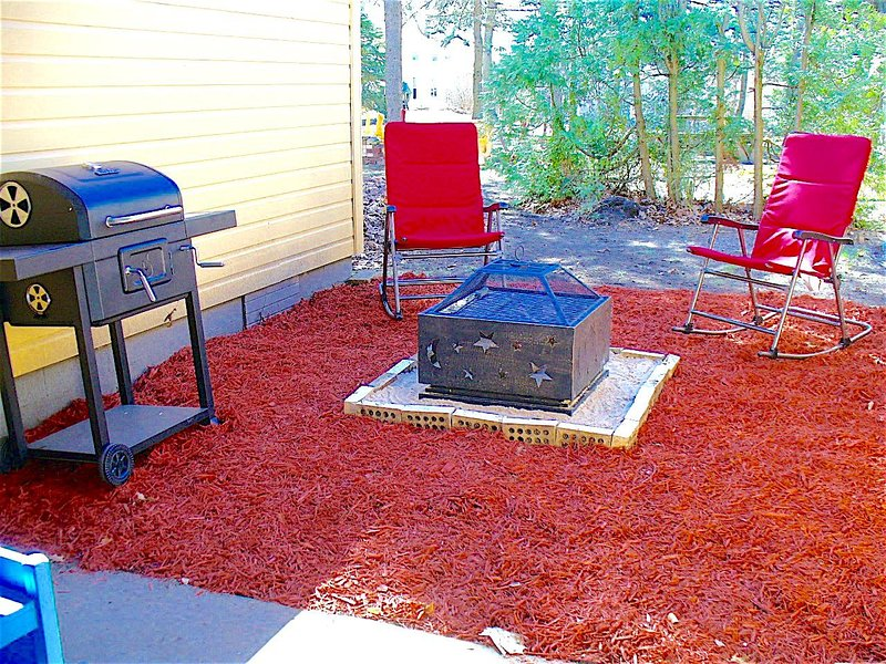 Private backyard, fire pit, charcoal grill, picnic table, lots of outdoor chairs