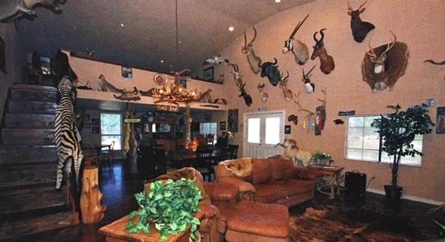 Trophy room is the guest house, sleeps 6 1/1+carport for RV, plenty of  parking, bar, rr, kitchen