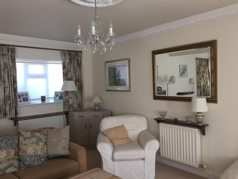 A cosy corner in the lounge at Thie Fuinnee, perfect for relaxing with a good book